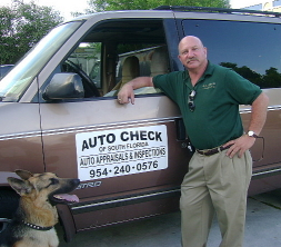 Dan with his service vehicle and his faithful dog Bandit